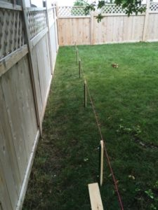 Setting posts along a string line.